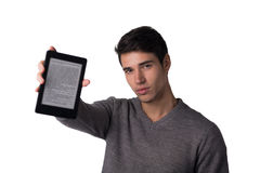 Handsome young man holding ebook reader Stock Photography