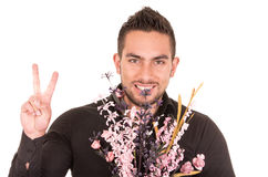Handsome young man holding a flower bouquet Royalty Free Stock Photography
