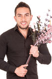Handsome young man holding a flower bouquet Stock Image