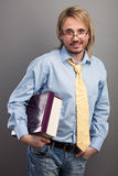 Handsome young man holding folder and book Stock Photo