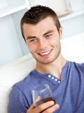 Handsome young man holding a glass of wine Royalty Free Stock Image