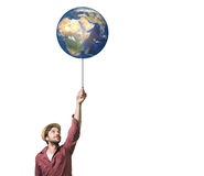 Handsome young man holding a  globe balloon Stock Photo