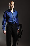 Handsome young man holding a gun. Stock Images