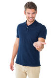 Handsome young man holding his hand out Stock Images