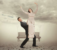 Handsome young man holding his woman stock photography