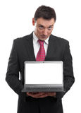 Handsome young man holding a laptop Royalty Free Stock Photography