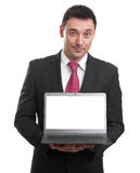 Handsome young man holding a laptop Royalty Free Stock Images
