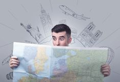 Young man holding map Stock Photo