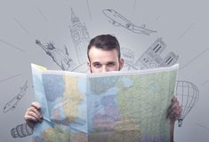 Young man holding map Stock Photos