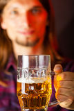 Handsome young man holding a mug of beer Royalty Free Stock Image