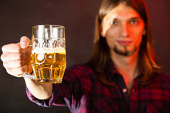 Handsome young man holding a mug of beer Stock Images