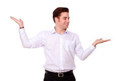 Handsome young man holding out his palms Royalty Free Stock Photo