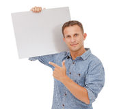 A handsome young man holding a placard Royalty Free Stock Photography