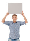 A handsome young man holding a placard Stock Photo