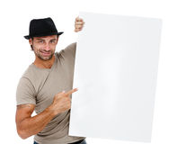 A handsome young man holding a placard Royalty Free Stock Photos