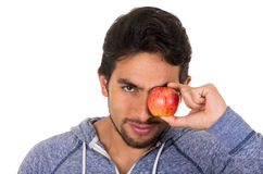 Handsome young man holding red apple Royalty Free Stock Image