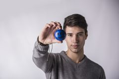 Handsome young man holding small ball with smiley Royalty Free Stock Photo