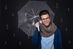 Handsome young man holding an umbrella. Stock Image