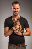 Handsome young man holding a yorkshire terrier dog.  Royalty Free Stock Photo