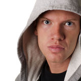 Handsome young man in a hood. With blue eyes Stock Image