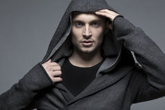 Handsome young man in a hood. Handsome european man in a hood Stock Images