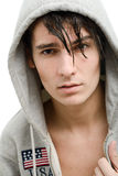 Handsome young man in a hood. Portrait of a handsome young man in a hood Royalty Free Stock Photo