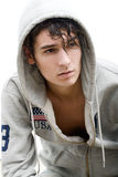 Handsome young man in a hood. Portrait of a handsome young man in a hood Royalty Free Stock Photography