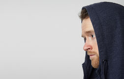 Handsome young man in a hood. Royalty Free Stock Photography