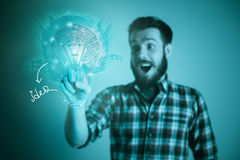Handsome young man with idea bulb on blue Royalty Free Stock Photos