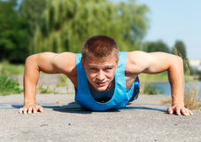 Free Handsome Young Man In Good Shape Doing Push-up While Outdoor Tra Royalty Free Stock Image - 51896826