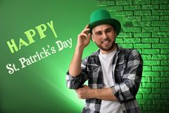 Free Handsome Young Man In Green Hat On Color Background. St. Patrick\ S Day Celebration Stock Image - 150014111
