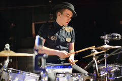 Handsome Young Man In Hat Plays Drum Set Stock Photo