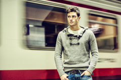 Handsome young man inside train station looking Royalty Free Stock Photos
