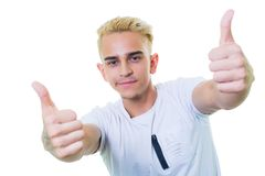 Handsome young man on an isolated background looking at camera. big thumbs up like. Handsome young man on an isolated background stock image