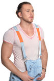 Handsome young man in jean overall Stock Photo