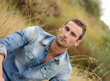 Handsome young man in jeans jacket Royalty Free Stock Photography