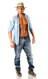Handsome young man in jeans with straw hat Royalty Free Stock Photography