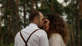 Handsome young man kisses a young woman luxurious. Walking in the summer Park. stock video