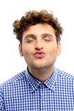 Handsome young man kissing camera Royalty Free Stock Photos