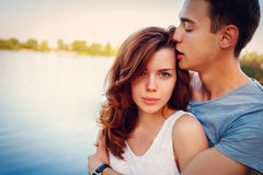 Handsome young man kissing his girlfriend Royalty Free Stock Photos