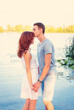 Handsome young man kissing his girlfriend Stock Images
