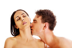 Handsome young man kissing woman`s neck. Stock Photo