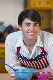Handsome young man in kitchen Stock Photos