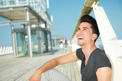 Handsome young man laughing outdoors on a summer day Royalty Free Stock Photography