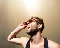 Handsome young man laughing with sunglasses Stock Photo