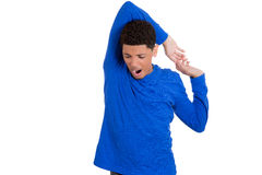 Handsome young man lazily stretching arms shoulders Royalty Free Stock Image