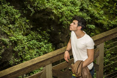 Handsome Young Man Leaning Against Pathway Rail Stock Images