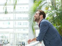 Handsome young man leaning inside bright building Royalty Free Stock Photo
