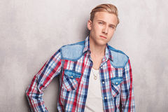 Handsome young man leaning on a wall Stock Photos