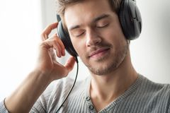 Handsome young man listening to music. Stock Photography